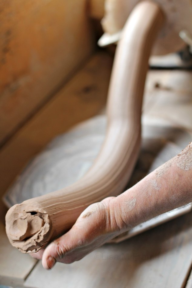 Ropes of clay coming out of the extruder at East Fork www.handmadenc.com